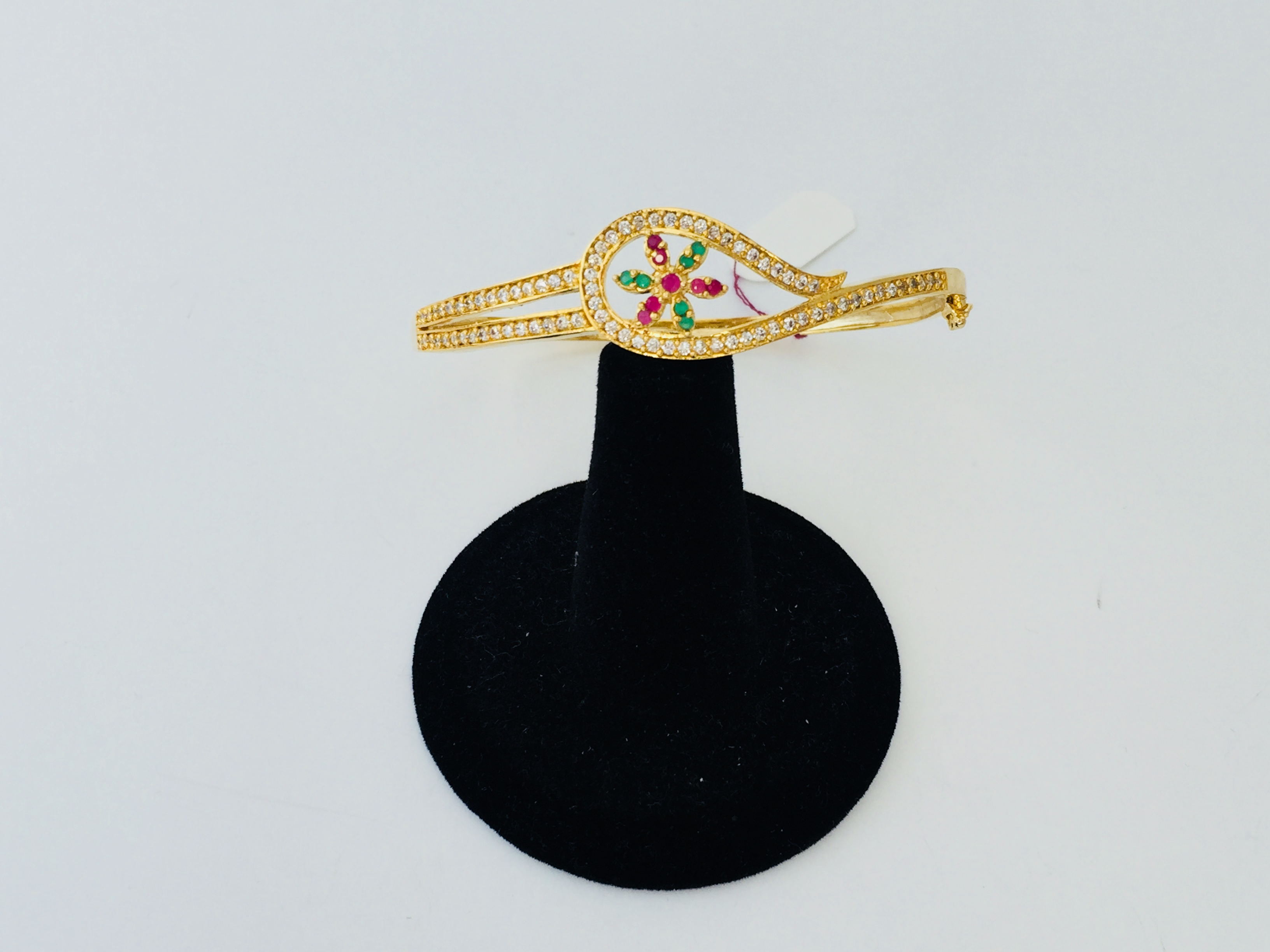 e5cb352ea33 Gorgeous Red and Green stone Floral Gold Bangle Bracelet decked in high  quality White Stones. A must buy!